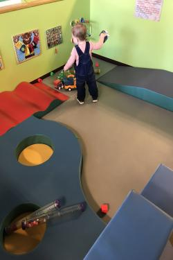 A child playing in the baby area