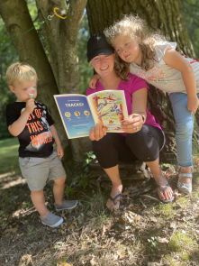parent and kids reading book