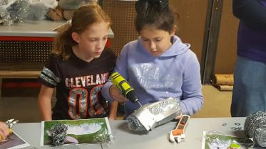 Two children building in the maker space